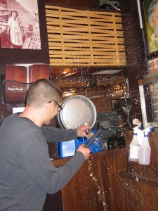 Owen getting wet tapping a cask!